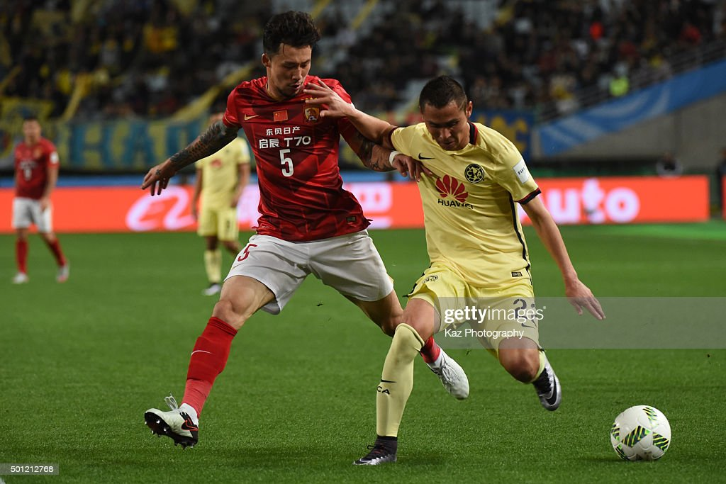 Paul Aguilar of the Club America keeps the ball under the pressure from Zhang Linpeng of Guangzhou Evergrande FC during the FIFA Club World Cup...