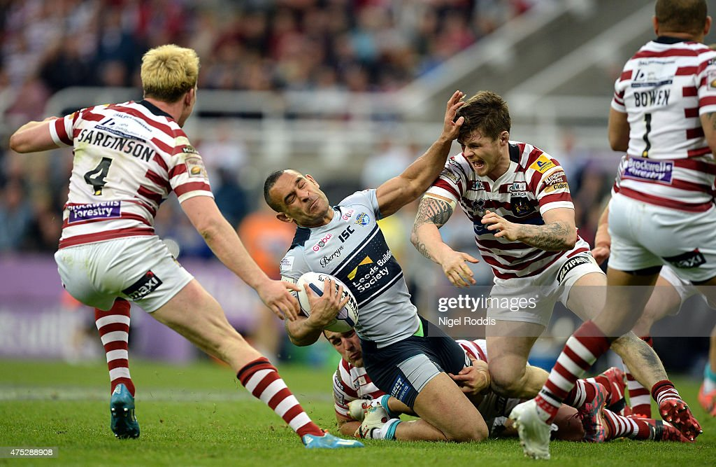 Paul Aiton (C) of Leeds Rhinos tackled by John Bateman of Wigan Warriors during the Super League match between Leeds Rhinos and Wigan Warriors at St James' Park on May 30, 2015 in Newcastle upon Tyne, England.