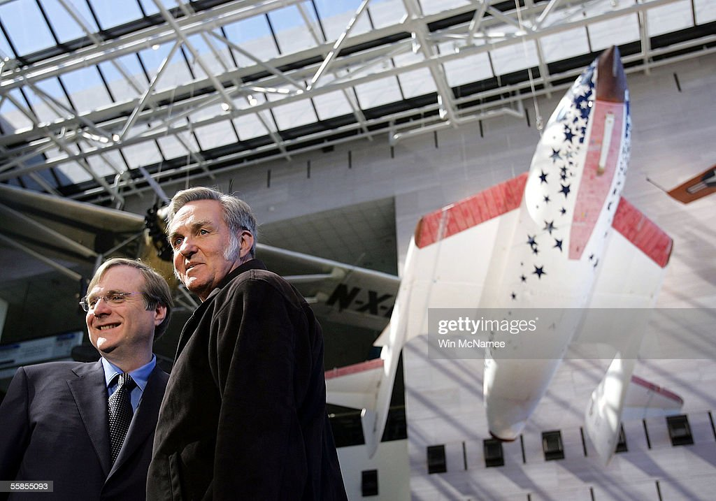 Paul Allen (L), founder and Burt Rutan (R), designer of SpaceShipOne pose for photographs following a news conference to mark the donation of SpaceShipOne (shown in background) to the National Air and Space Museum October 5, 2005 in Washington, DC. SpaceShipOne was the first privately built and piloted vehicle to reach space and will be on permanent display between Charles Lindbergh's Spirit of St. Louis and Chuck Yeager's Bell X-1.