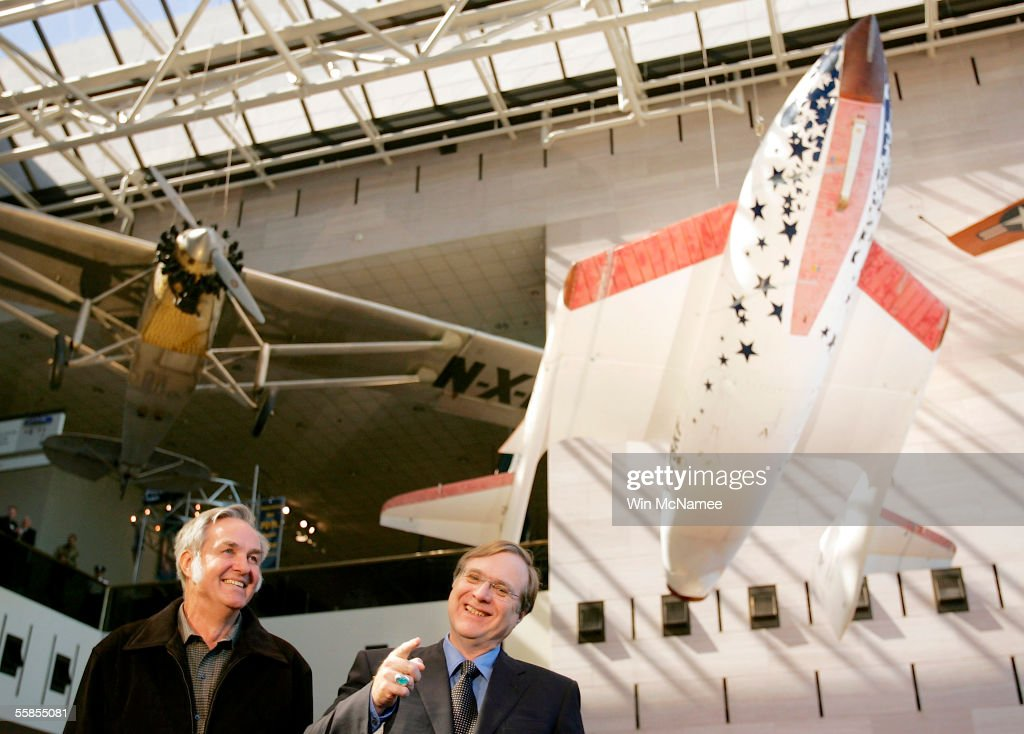 Paul Allen (L), founder and Burt Rutan (R), designer of SpaceShipOne take part in a news conference to mark the donation of SpaceShipOne (shown in background) to the National Air and Space Museum October 5, 2005 in Washington, DC. SpaceShipOne was the first privately built and piloted vehicle to reach space and will be on permanent display between Charles Lindbergh's Spirit of St. Louis and Chuck Yeager's Bell X-1.
