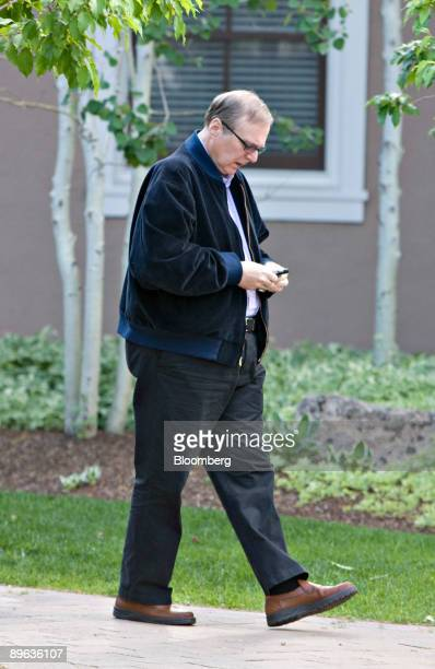 Paul Allen senior strategy advisor and cofounder of Microsoft Inc uses a cell phone during the Allen Co Media and Technology Conference in Sun Valley...