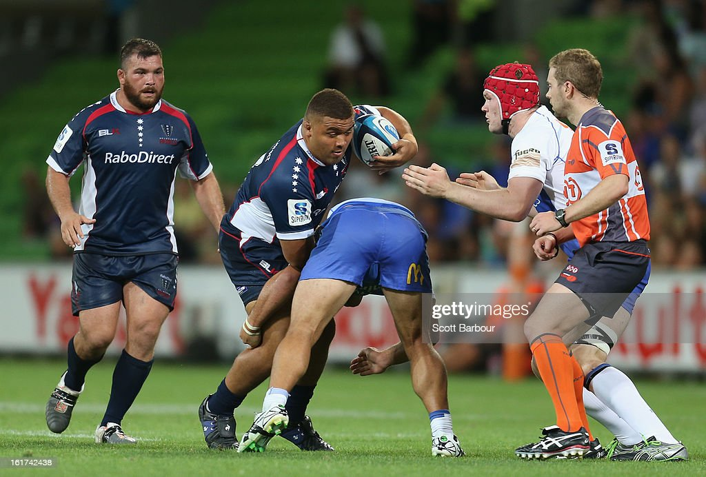 Paul Alo-Emile of the Rebels is tackled during the round one Super Rugby match between the Rebels and the Force at AAMI Park on February 15, 2013 in Melbourne, Australia.