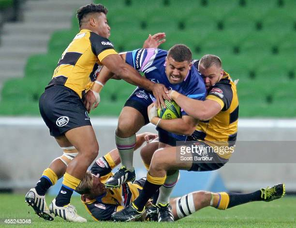 Paul AloEmile of the Rising is tackled during the round four National Rugby Championship match between Melbourne Rising and Perth Spirit at AAMI Park...