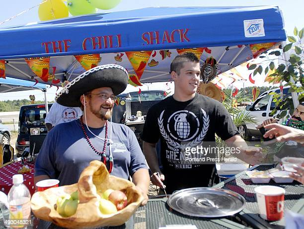 Paul and Cameron Williams of Scarborough serve chile to visitors during the 'Cook Off' that was sanctioned by the International Chili Society held at...