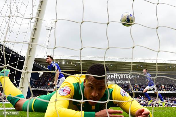 Paul Anderson of Ipswich scores past defender Martin Olsson of Norwich during the Sky Bet Championship Playoff semifinal first leg match between...