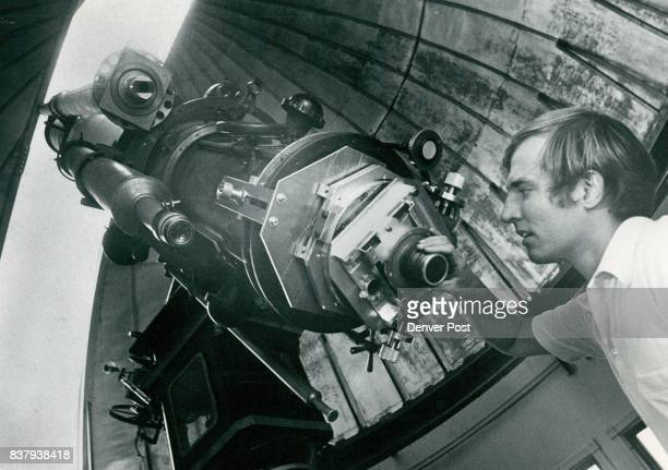 Paul Asmus adjusts telescope at Chamberlain Observatory At left domed ceiling's shutter is open to the sky The 20inch refractor telescope was built...
