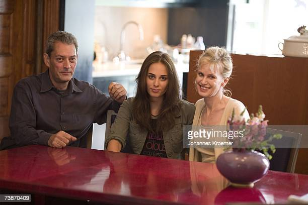 Paul Auster daughter Sophie Auster and wife Siri Hustved pose for a photo at their dining table in their Brooklyn home on July 11 2006