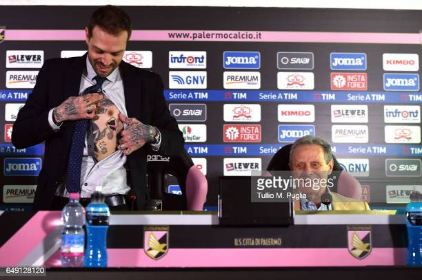 Paul Baccaglini new President of US Citta' di Palermo shows a tatoo diplaying a logo of Palermo as former President Maurizio Zamparini looks on...