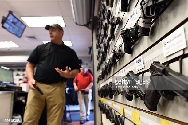 Paul Bastean owner of the Ultimate Defense Firing Range and Training Center in St Peters Missouri some 20 miles west of Ferguson arranges a rack of...