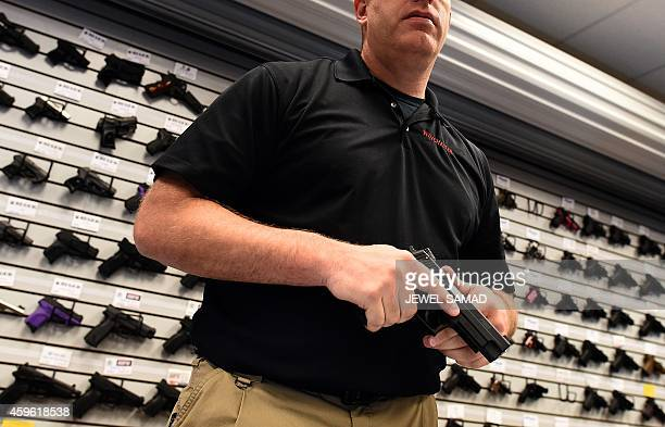 Paul Bastean owner of the Ultimate Defense Firing Range and Training Center in St Peters Missouri some 20 miles west of Ferguson shows a handgun on...