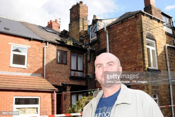 Paul Bates stands outside his house in Barnsley Road Wombwell where part of the roof collapsed injuring his son David during last night's earthquake...