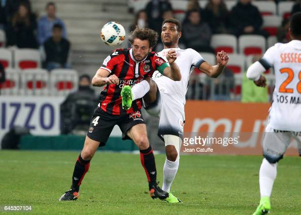 Paul Baysse of Nice and Steve Mounie of Montpellier in action during the French Ligue 1 match between OGC Nice and Monptellier Herault SC at Allianz...