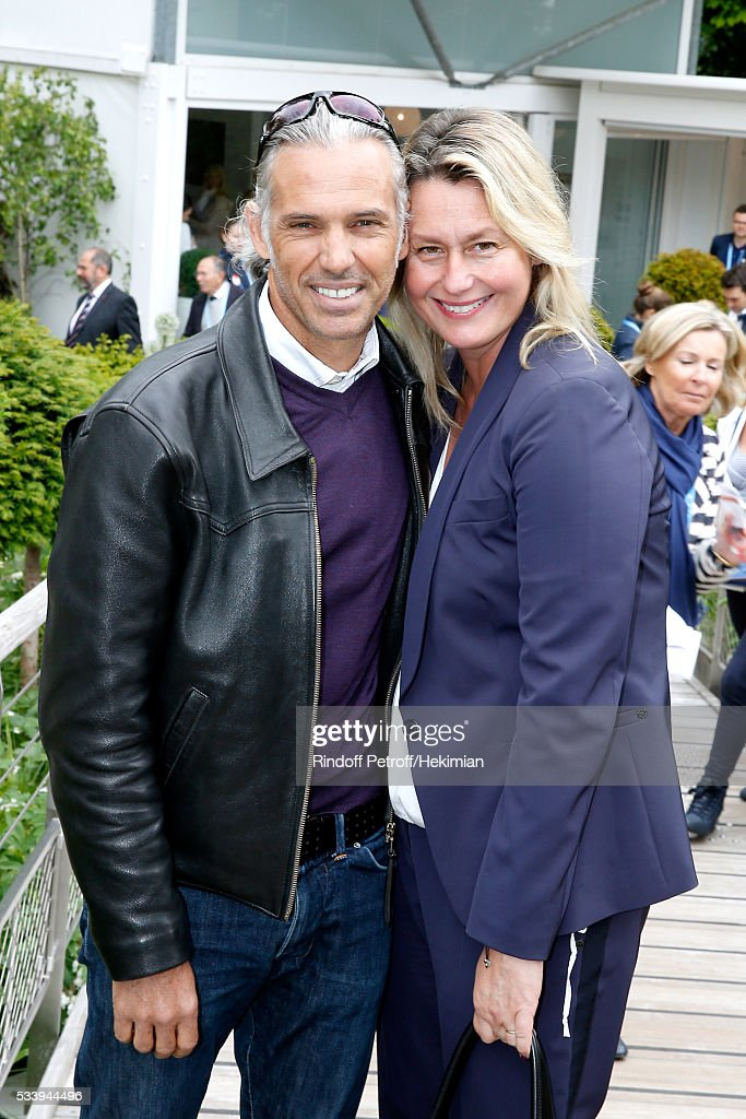 Paul Belmondo and his wife Luana attend the 2016 French Tennis Open - Day Three at Roland Garros on May 24, 2016 in Paris, France.