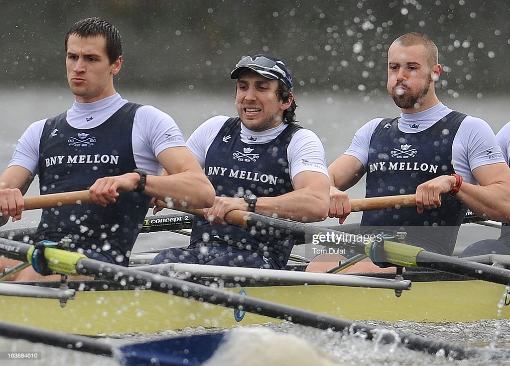 Paul Bennett, Sam O'Connor and Alex Davidson of The Oxford Blue Boat in action during the training race against German Eight on the River Thames on March 17, 2013 in London, England.