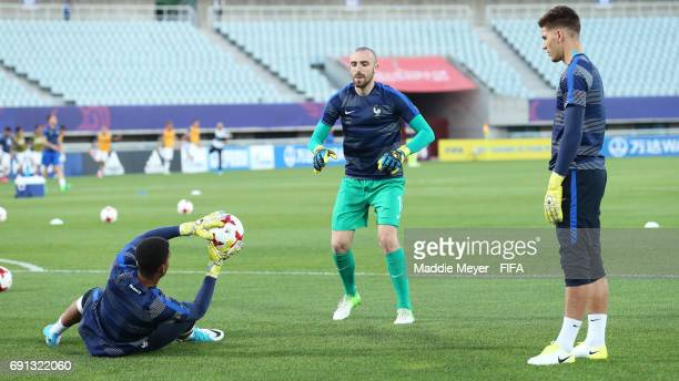 Paul Bernardoni Alban Lafont and Quentin Braat of France warm up before the FIFA U20 World Cup Korea Republic 2017 Round of 16 match between France...