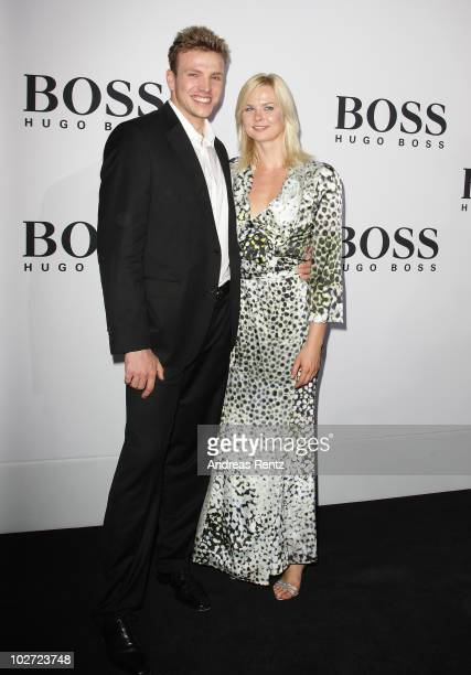 Paul Biedermann and partner Britta Steffen arrive at the Boss Black Show during the MercedesBenz Fashion Week Spring/Summer 2011 on July 8 2010 in...