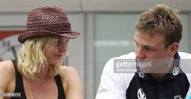 Paul Biedermann of SV Halle/Saale and his girlfriend swimmer Britta Steffen are seen after the men's 200 m freestyle A final during the German...