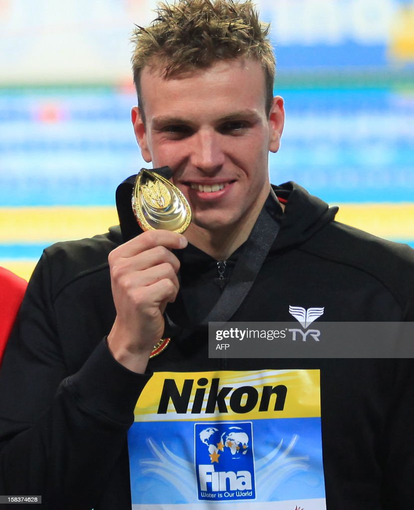 Paul Bierdermann of Germany bites his gold medal after winning the men's 400m Freestyle final during the FINA World Short Course Swimming Championships in Istanbul on December 14, 2012.
