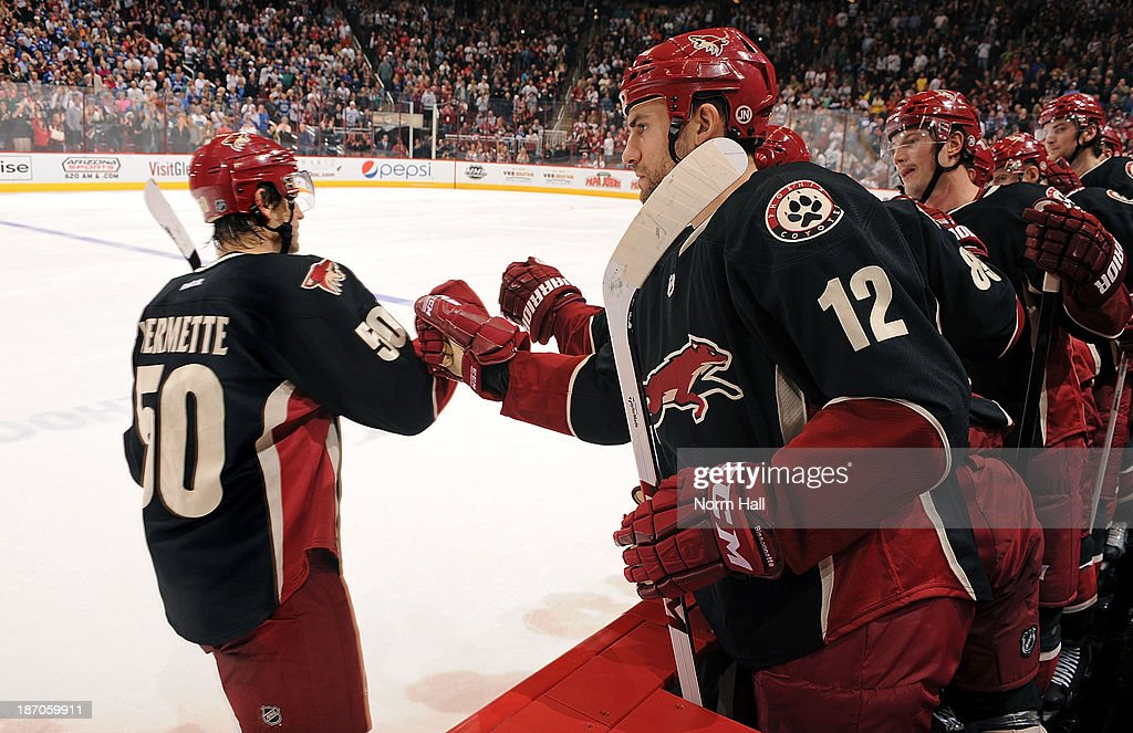 <a gi-track='captionPersonalityLinkClicked' href=/galleries/search?phrase=Paul+Bissonnette&family=editorial&specificpeople=2235151 ng-click='$event.stopPropagation()'>Paul Bissonnette</a> #12 and <a gi-track='captionPersonalityLinkClicked' href=/galleries/search?phrase=Shane+Doan&family=editorial&specificpeople=201614 ng-click='$event.stopPropagation()'>Shane Doan</a> #19 of the Phoenix Coyotes congratulate teammate <a gi-track='captionPersonalityLinkClicked' href=/galleries/search?phrase=Antoine+Vermette&family=editorial&specificpeople=206302 ng-click='$event.stopPropagation()'>Antoine Vermette</a> #50 on his shootout goal against the Vancouver Canucks at Jobing.com Arena on November 5, 2013 in Glendale, Arizona. The Coyotes defeated the Canucks 3-2.