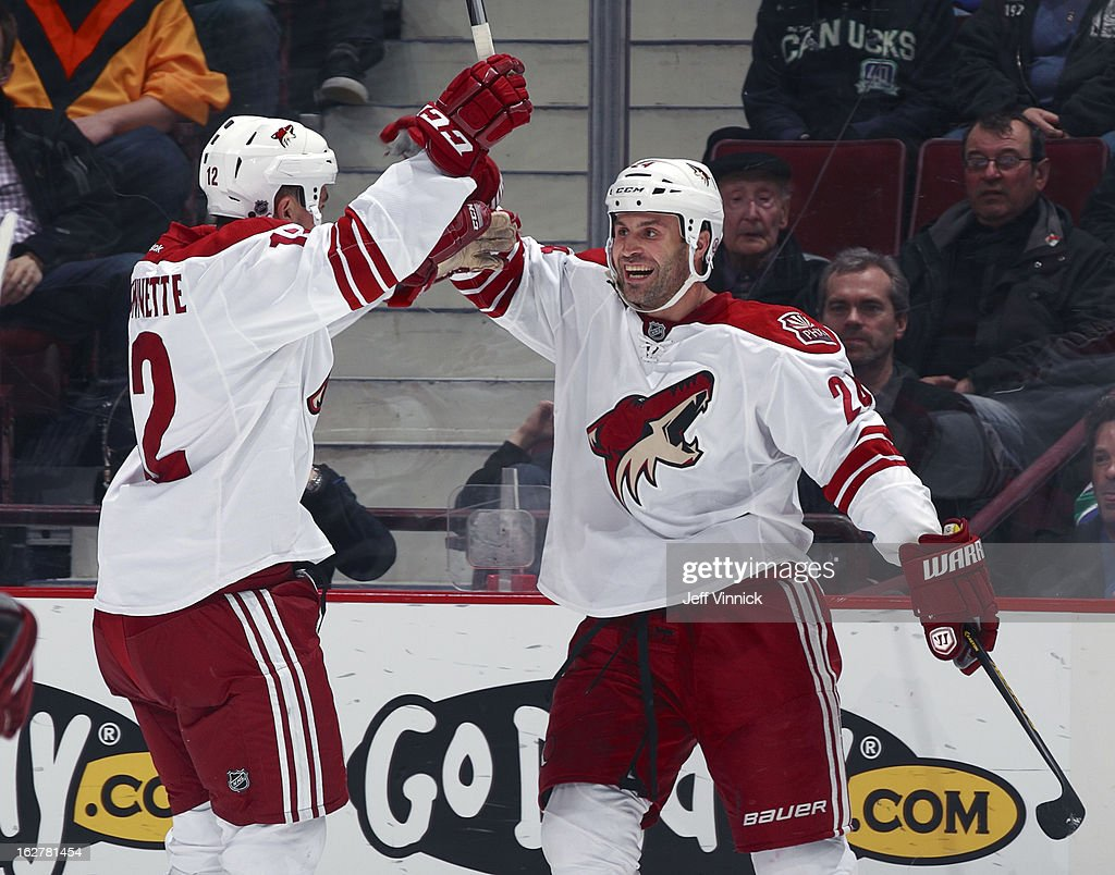 Paul Bissonnette #12 of the Phoenix Coyotes congratulates goal scorer Kyle Chipchura #24 of the Phoenix Coyotes during their NHL game against the Vancouver Canucks at Rogers Arena February 26, 2013 in Vancouver, British Columbia, Canada.