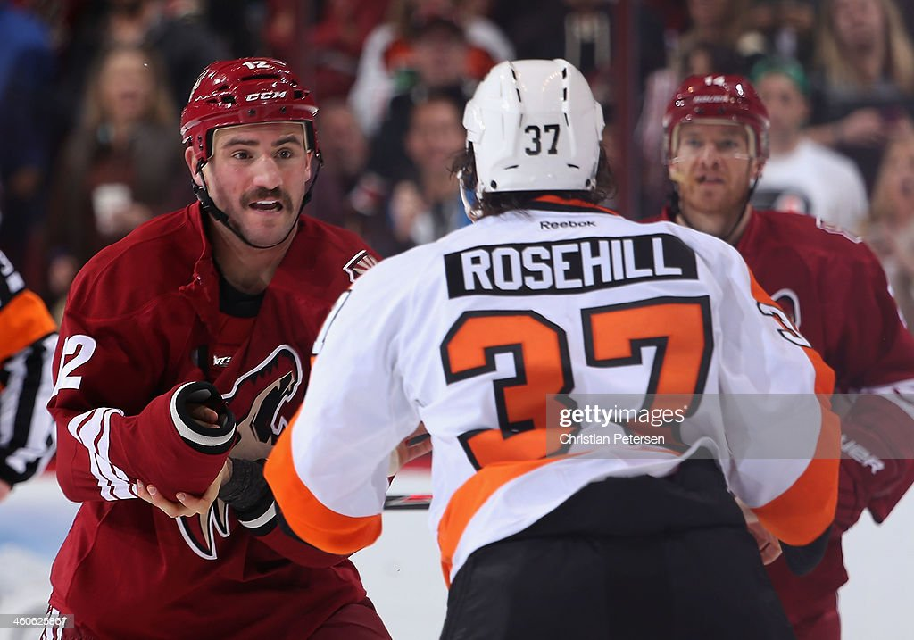 Paul Bissonnette of the Phoenix Coyotes fights with Jay Rosehill of the Philadelphia Flyers during the second period of the NHL game at Jobingcom...