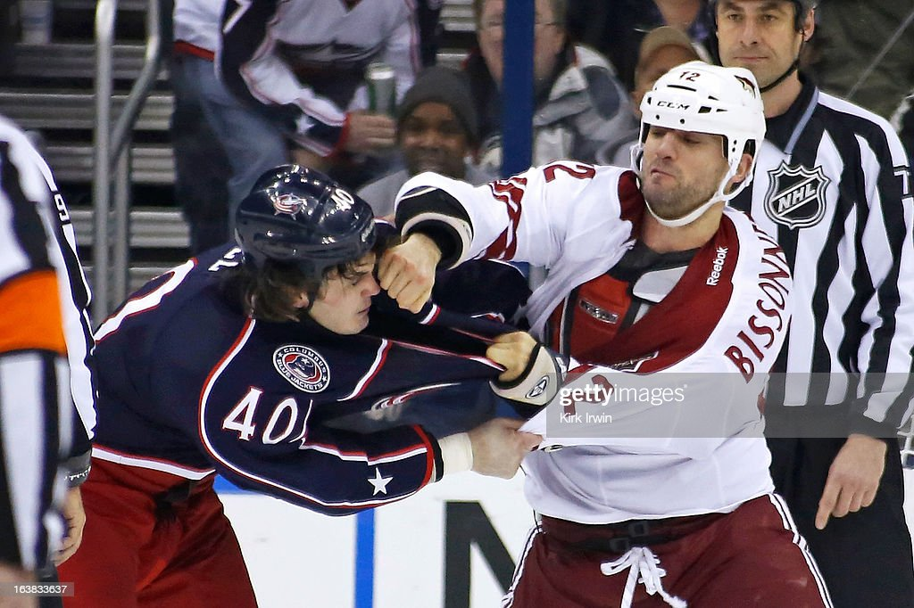 Paul Bissonnette #12 of the Phoenix Coyotes punches Jared Boll #40 of the Columbus Blue Jackets during a fight in the second period on March 16, 2013 at Nationwide Arena in Columbus, Ohio.