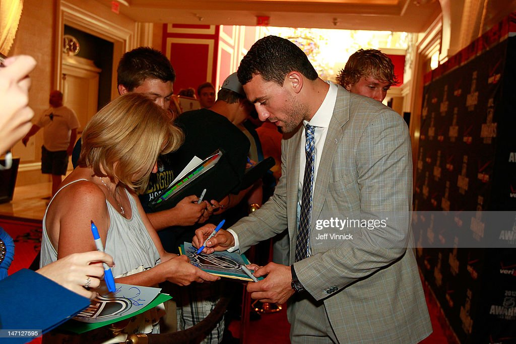 Paul Bissonnette of the Phoenix Coyotes signs an autograph as he arrives before the 2012 NHL Awards at the Encore Theater at the Wynn Las Vegas on June 20, 2012 in Las Vegas, Nevada.
