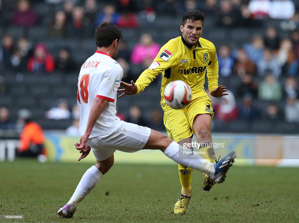 Paul Black (R) of Tranmere Rovers plays the ball past George Baldock of MK Dons during the npower League One match between MK Dons and Tranmere Rovers at Stadium MK on March 16, 2013 in Milton Keynes, England.