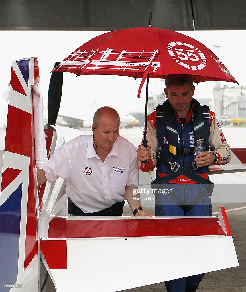 <a gi-track='captionPersonalityLinkClicked' href=/galleries/search?phrase=Paul+Bonhomme&family=editorial&specificpeople=2949778 ng-click='$event.stopPropagation()'>Paul Bonhomme</a> (R) of Great Britain returns to his hangar with technician Wade Hammond as bad weather delays flying during the Red Bull Air Race Day at the Race Airport on May 9, 2010 in Rio de Janeiro, Brazil.