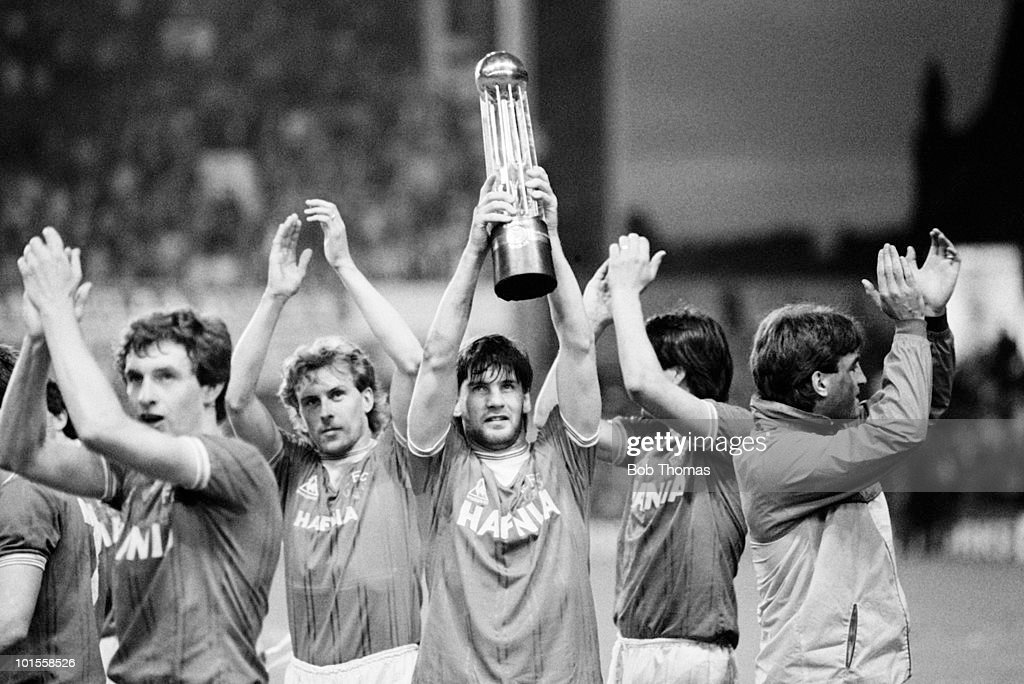 Paul Bracewell of Everton holds aloft the Football League Division 1 Championship trophy following the Everton v West Ham United Division 1 match played at Goodison Park, Liverpool on the 8th May 1985. Left to right; Kevin Sheedy, Kevin Richardson, Paul Bracewell, Graeme Sharp and Kevin Ratcliffe. Everton won the match 3-0.