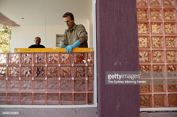 Paul Brasser from the Glass Brick Company installs glass bricks at a residential property in BrightonleSands 7 June 2006 SMH Picture by MARCO DEL...