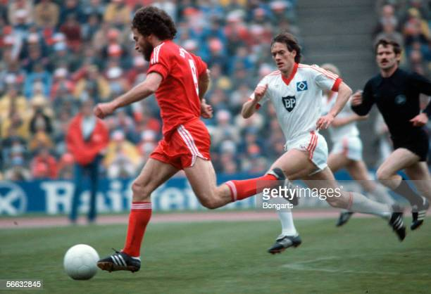 Paul Breitner of Bayern and Bernd Wehmeyer of Hamburg battle for the ball during the Bundesliga match between Bayern Munich and Hamburger SV at the...