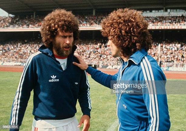 Paul Breitner of Bayern Munich and Kevin Keegan of Hamburg talk before the Bundesliga match between Hamburger SV and Bayern Munich at the...