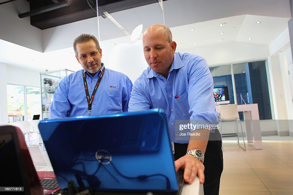 Paul Brener (L) and David Tabb check out a Dell computer on display at the Electric Avenue store on February 5, 2013 in Miami, Florida. Dell Inc. today announced it will be taken private in a deal valued at about $24.4 billion. The company will be acquired by Dell founder and Chief Executive Michael S. Dell and global technology investment firm Silver Lake and Microsoft Corp. will invest $2 billion in the deal.