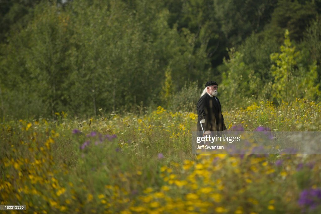 Paul Britton, whose sister Marion Britton was among the crash victims, walks back from the crash site at the Flight 93 National Memorial during ceremonies commemorating the 12th anniversary of the 9/11 attacks on September 11, 2013 in Shanksville, Pennsylvania. The nation is commemorating the anniversary of the 2001 attacks, which resulted in the deaths of nearly 3,000 people after two hijacked planes crashed into the World Trade Center, one into the Pentagon in Arlington, Virginia and one crash landed in Shanksville, Pennsylvania.