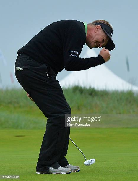 Paul Broadhurst of England celebrates after holing his final putt on 18 to win The Senior Open Championship at Carnoustie Golf Club on July 24 2016...