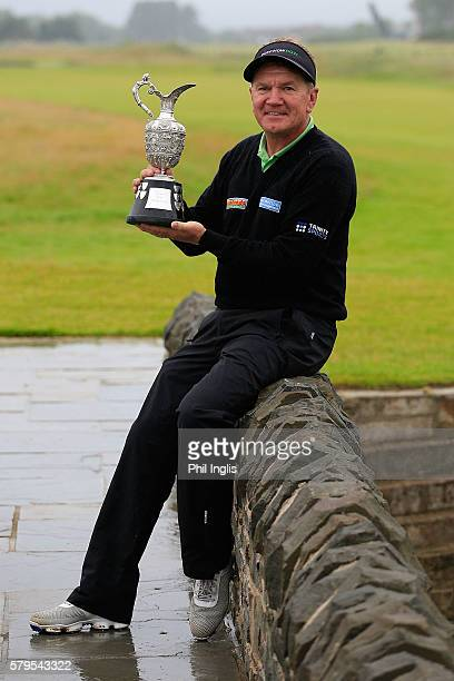 Paul Broadhurst of England poses with the trophy after the final round of the Senior Open Championship played at Carnoustie on July 24 2016 in...