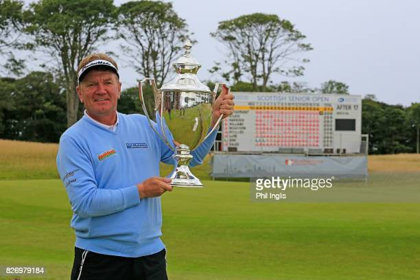Paul Broadhurst of England poses with the trophy after the final round of the Scottish Senior Open at The Renaissance Club on August 6 2017 in North...
