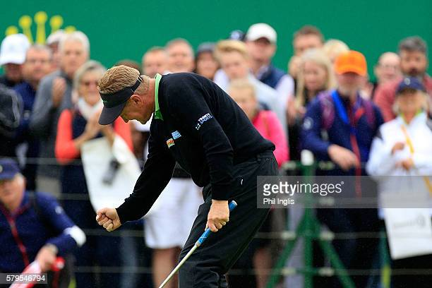 Paul Broadhurst of England reacts having holed the winning putt on the 18th green during the final round of the Senior Open Championship played at...