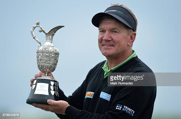 Paul Broadhurst of England Senior Open Trophy after holing his final putt on 18 to win The Senior Open Championship at Carnoustie Golf Club on July...