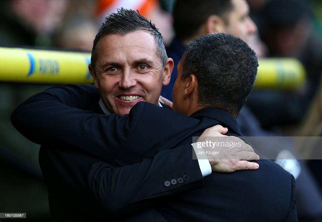 Paul Buckle, Manager of Luton Town and <a gi-track='captionPersonalityLinkClicked' href=/galleries/search?phrase=Chris+Hughton&family=editorial&specificpeople=646349 ng-click='$event.stopPropagation()'>Chris Hughton</a>, Manager of Norwich City embrace prior to kick off during the FA Cup with Budweiser fourth round match between Norwich City and Luton Town at Carrow Road on January 26, 2013 in Norwich, England.