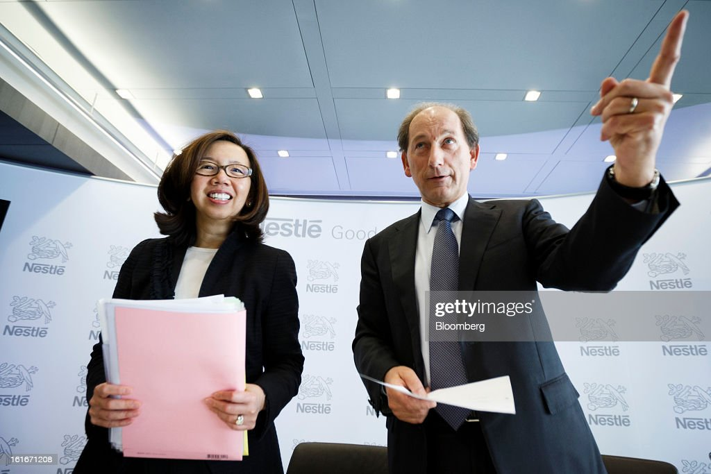 Paul Bulcke, chief executive officer of Nestle SA, right, and Wan Ling Martello, chief financial officer of Nestle SA, prepare to leave after a news conference to announce the company's annual results in Vevey, Switzerland, on Thursday, Feb. 14, 2013. Nestle SA said it expects 2013 to be as challenging as last year, when sales missed analysts' estimates on a slowdown in emerging markets, a region the world's largest food company is increasingly dependent upon. Photographer: Valentin Flauraud/Bloomberg via Getty Images