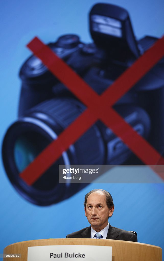 Paul Bulcke, chief executive officer of Nestle SA, sits beneath a 'no photography' sign ahead of the company's annual general meeting (AGM) in Lausanne, Switzerland, on Thursday, April 11, 2012. Nestle SA's chairman said Switzerland is becoming more difficult as a business location after voters last month approved some of the world's toughest limits on executives' pay. Photographer: Valentin Flauraud/Bloomberg via Getty Images