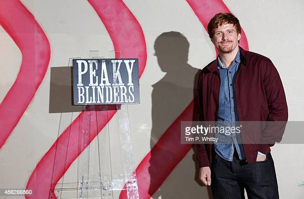 Paul Bullion poses for a photo ahead of a preview screening of the second series of 'Peaky Blinders' at Ham Yard Hotel on September 28 2014 in London...