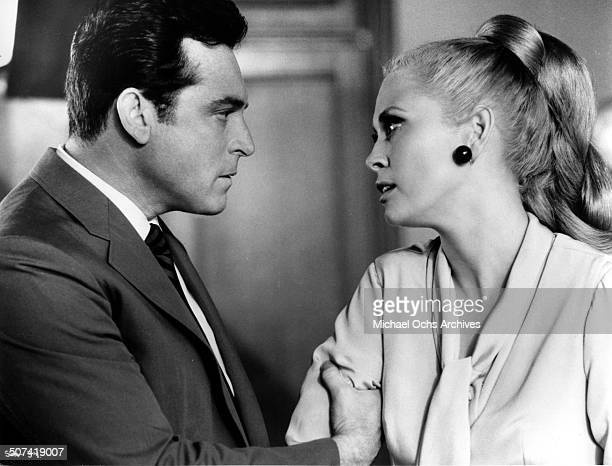 Paul Burke grabs Faye Dunaway in a scene from the movie 'The Thomas Crown Affair' circa 1968