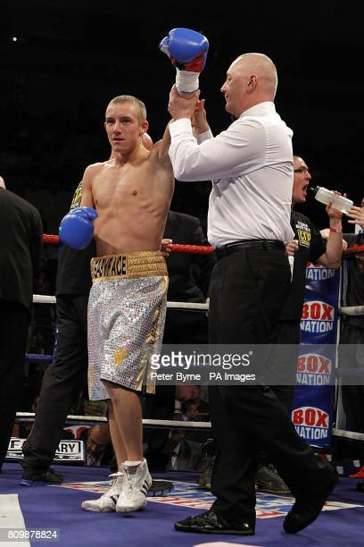 Paul Butler celebrates beating Arpad Vas in there SuperFlyweight Bout at the Echo Arena Liverpool
