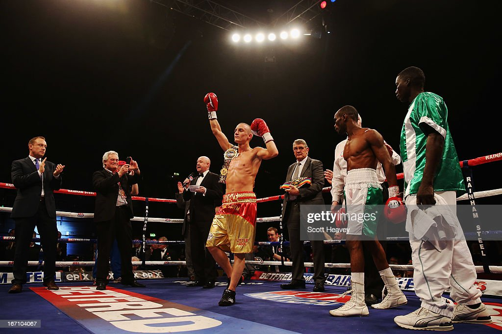 Paul Butler (C) celebrates victory over Yaqub Kareem (2R) after their Commonwealth Super-Flyweight Championship bout at Wembley Arena on April 20, 2013 in London, England.