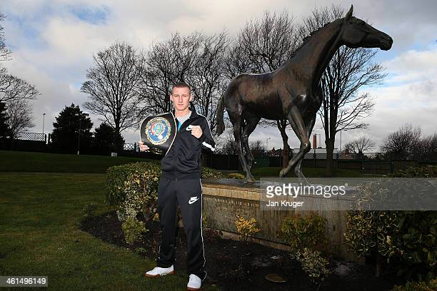 Paul Butler poses at a statue of Red Rum during a press conference at Aintree Racecourse on January 9 2014 in Liverpool England