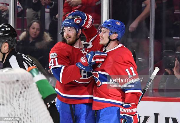 Paul Byron and Brendan Gallagher of the Montreal Canadiens celebrate after scoring a goal against the Ottawa Senators in the NHL game at the Bell...