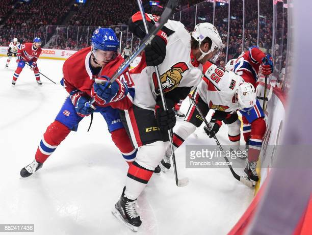 Paul Byron and Byron Froese of the Montreal Canadiens fight for the puck against Cody Ceci and Matt Duchene of the Ottawa Senators in the NHL game at...